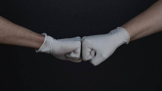 Helping hands in gloves