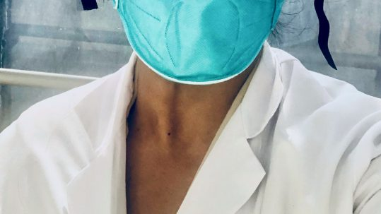 Physician wearing protective mask